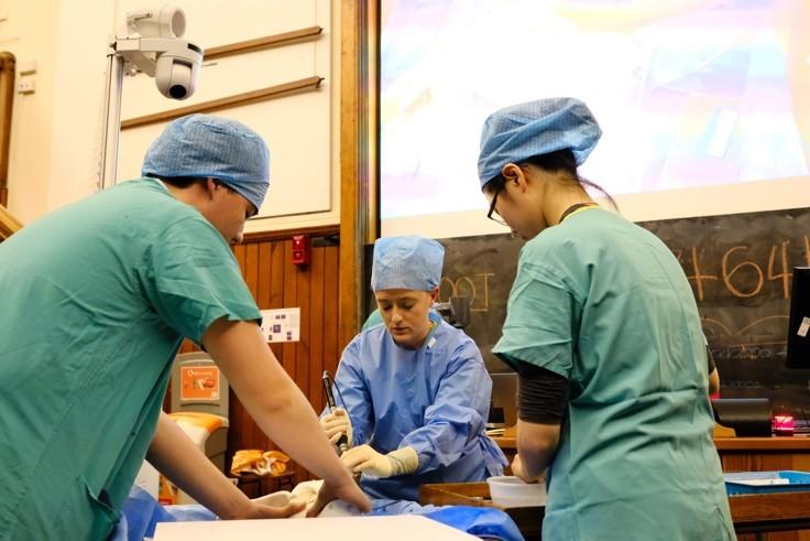 Doctors working on dummy
